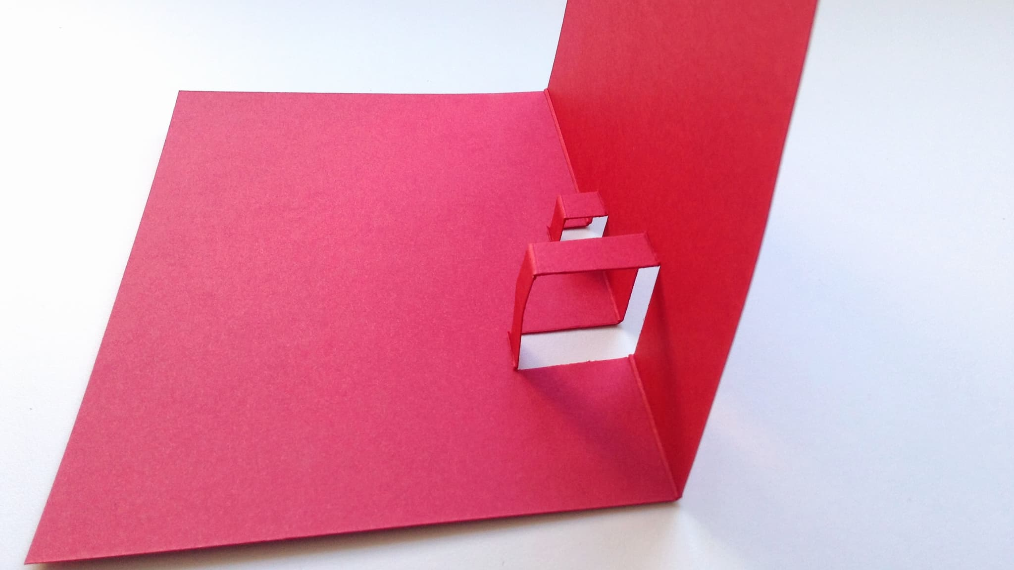 Fold the pop-out supports from the Valentine's card