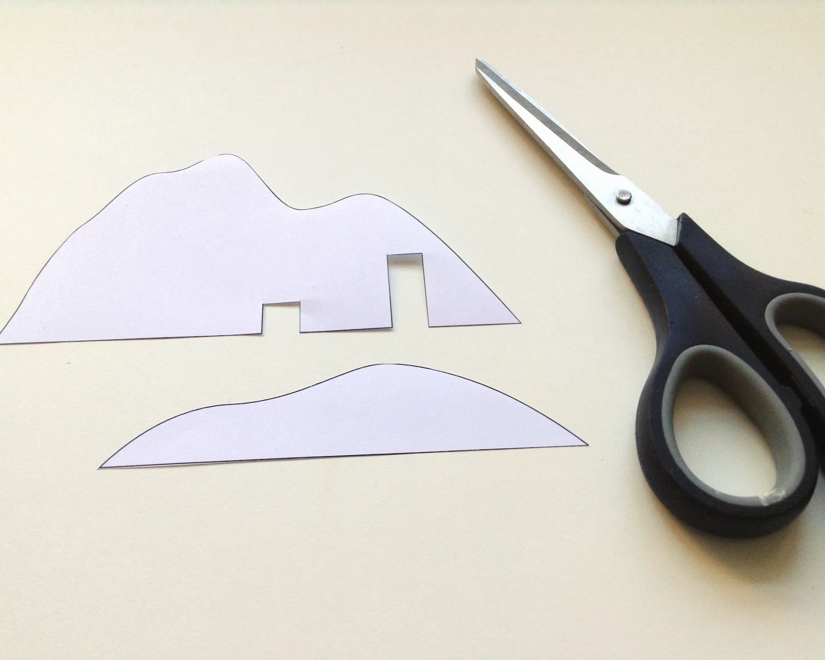 Cut out the mountain shapes