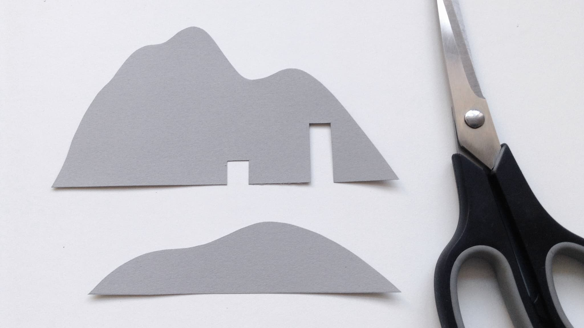 Cut out the mountain shapes from the grey card