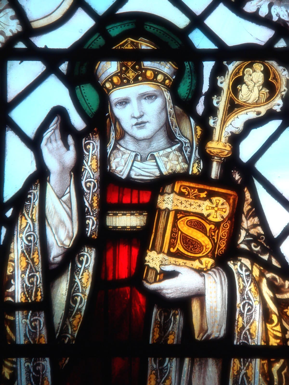 A stained glass depiction of St. Swithun
