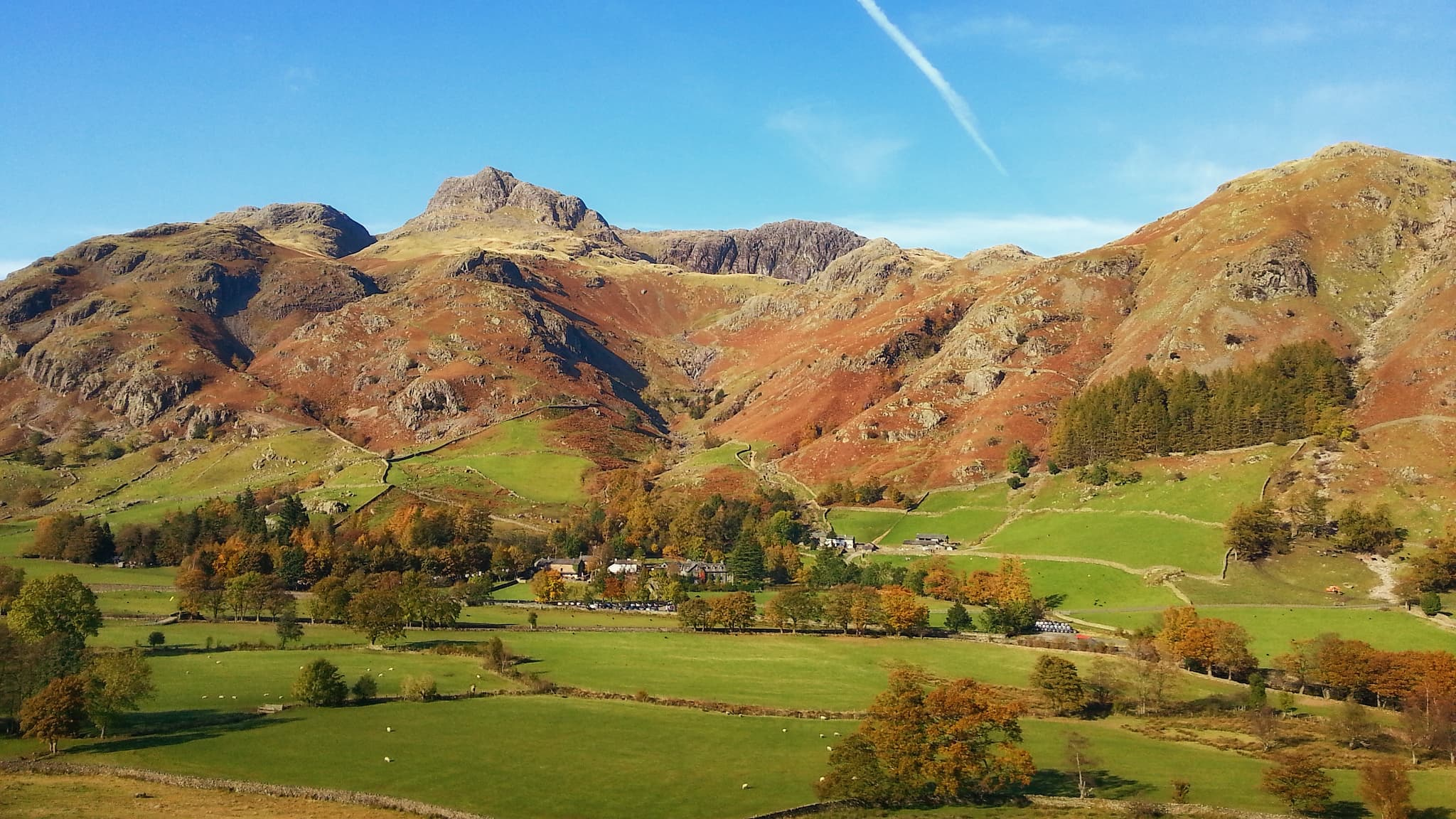 The Langdale Pikes in full autumn colours on a clear blue sky day