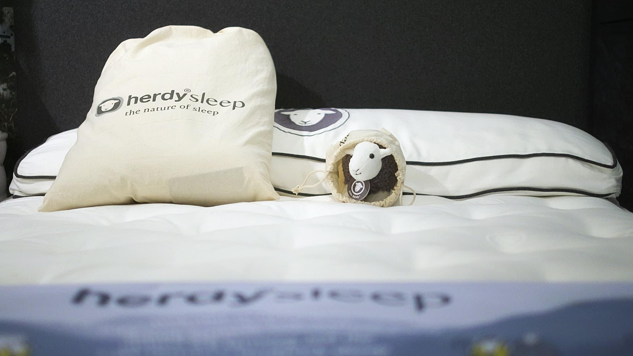 Little Herdy likes using a pillow cover as a sleeping bag on this Herdysleep mattress...