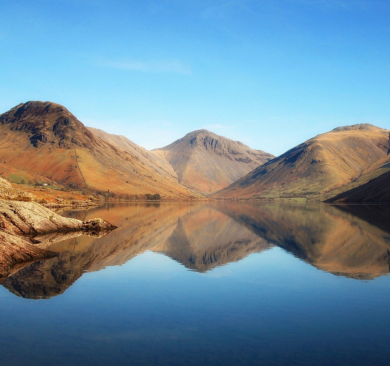 The view of the Wasdale fells from the foot of Wastwater, shot in the Spring, with perfect reflections. Fells are Yewbarrow on the left, Great Gable in the centre, and Lingmell on the right.