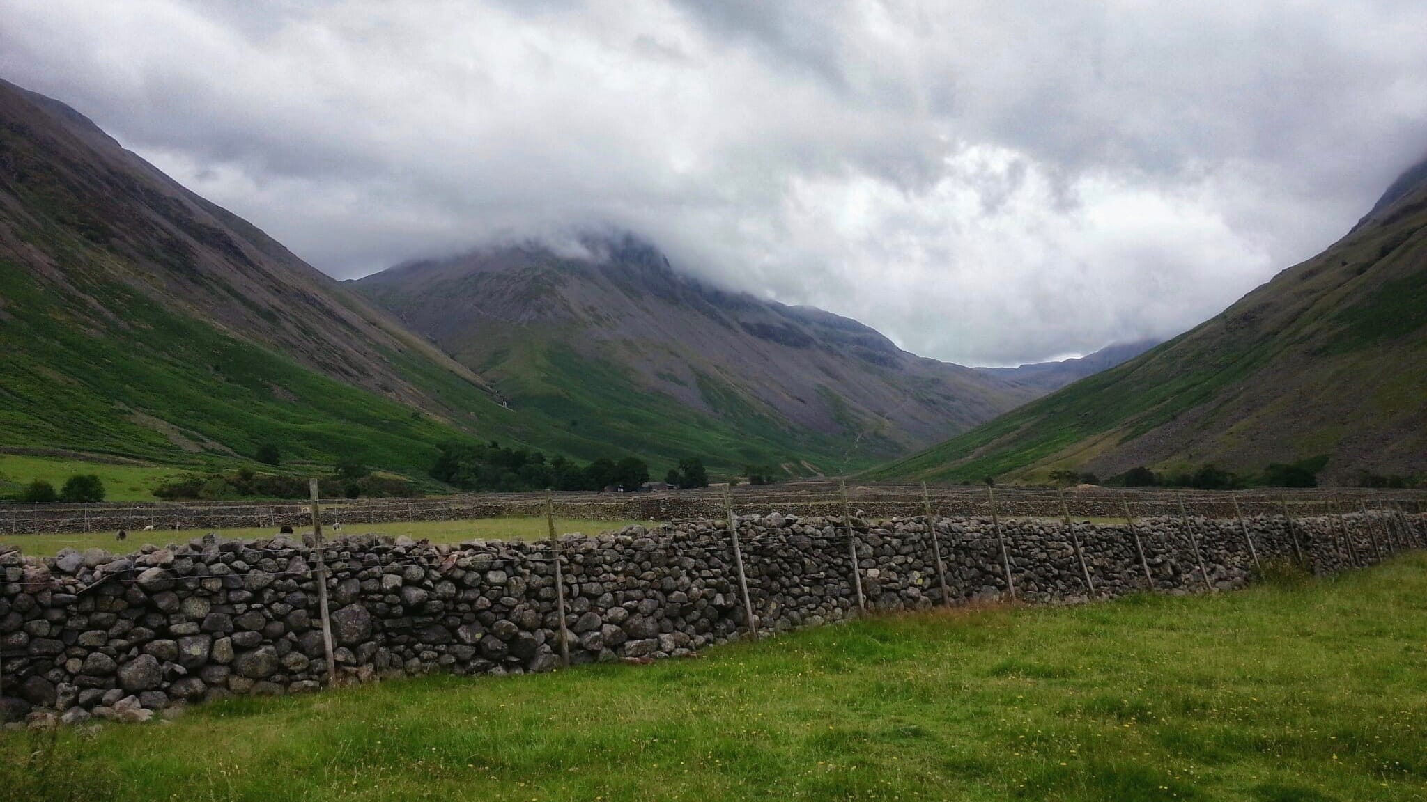 The view of Great Gable from Wasdale Head, it's summit slightly obscured by the clouds overhead.