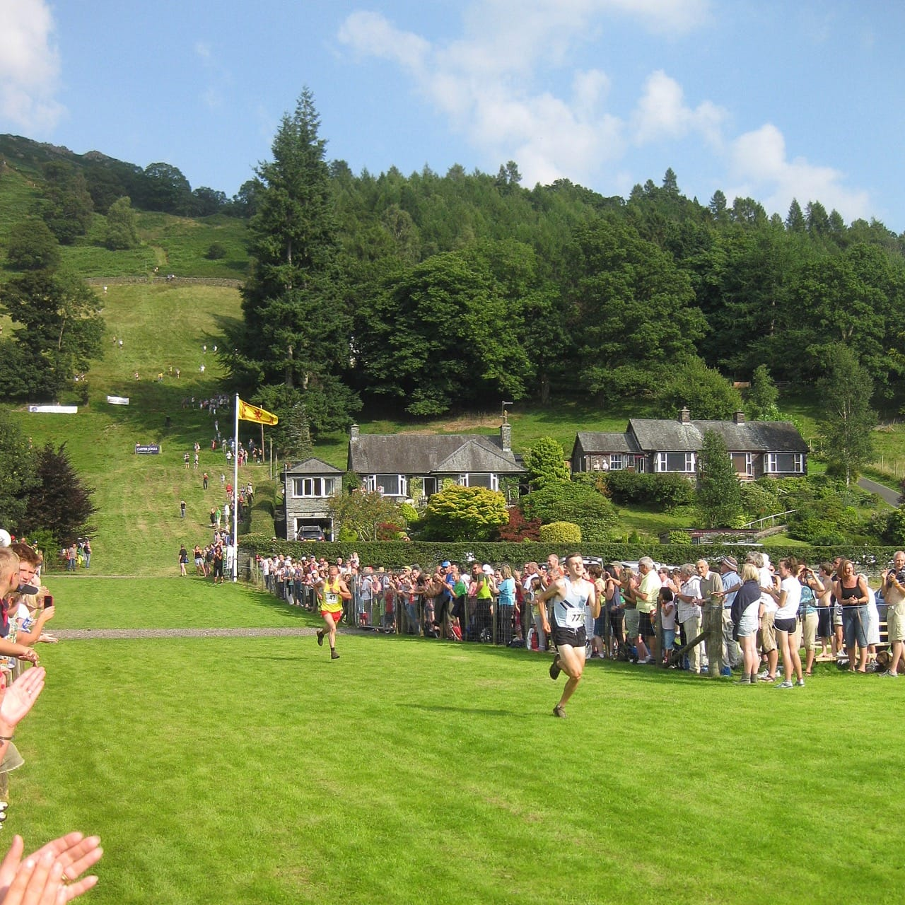 Fell runners finish coming off the fells at the Grasmere Sports Day. Photo by Wolf Gang