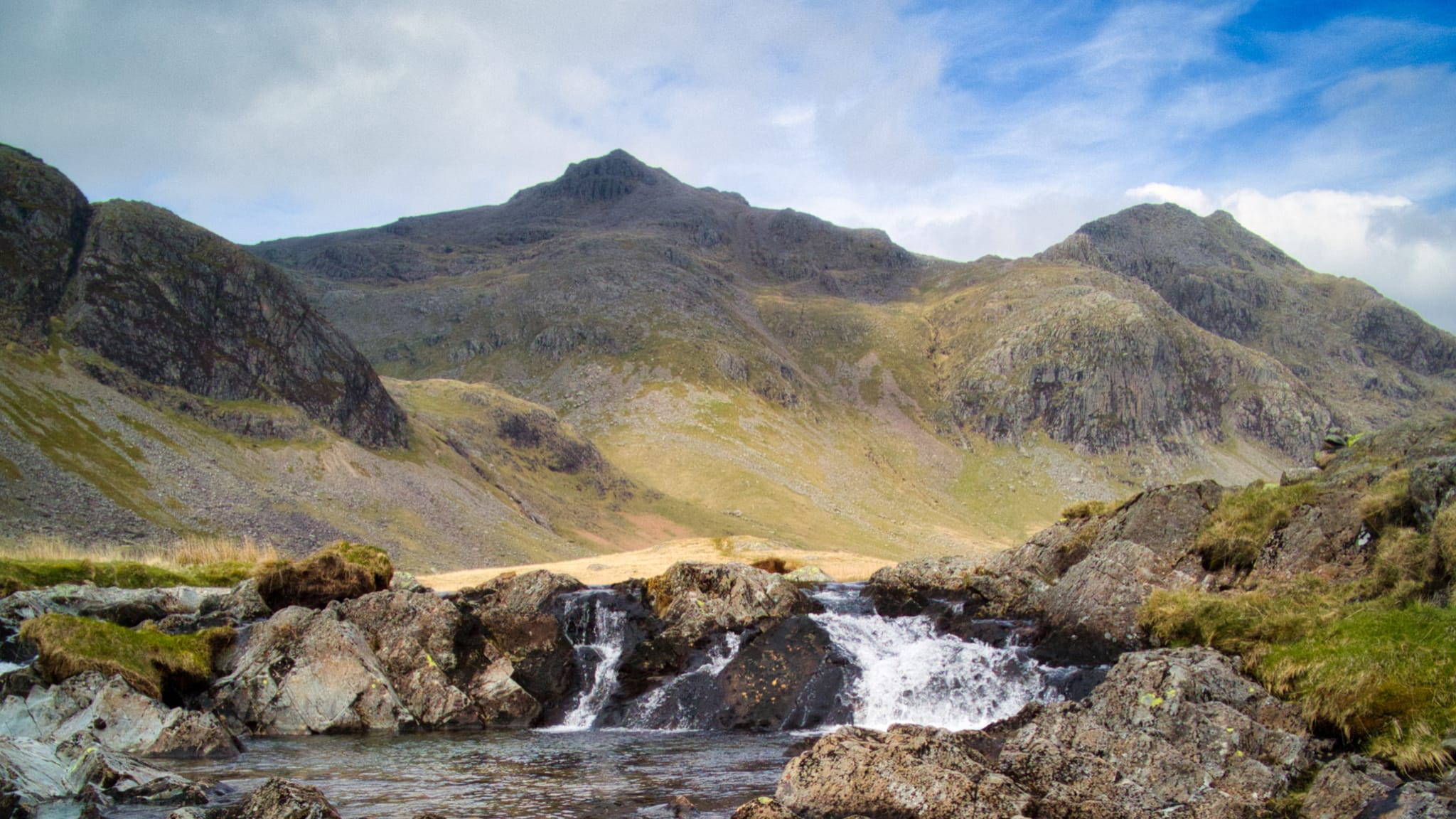 A view of Scafell Pike and its nearby fells from the Great Moss hanging valley above Eskdale