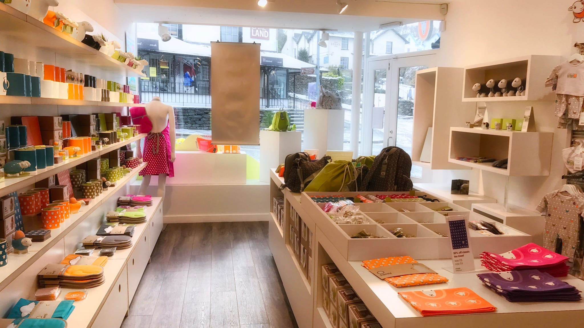 Inside the Herdy Bowness shop, surrounded by colourful Herdy products.