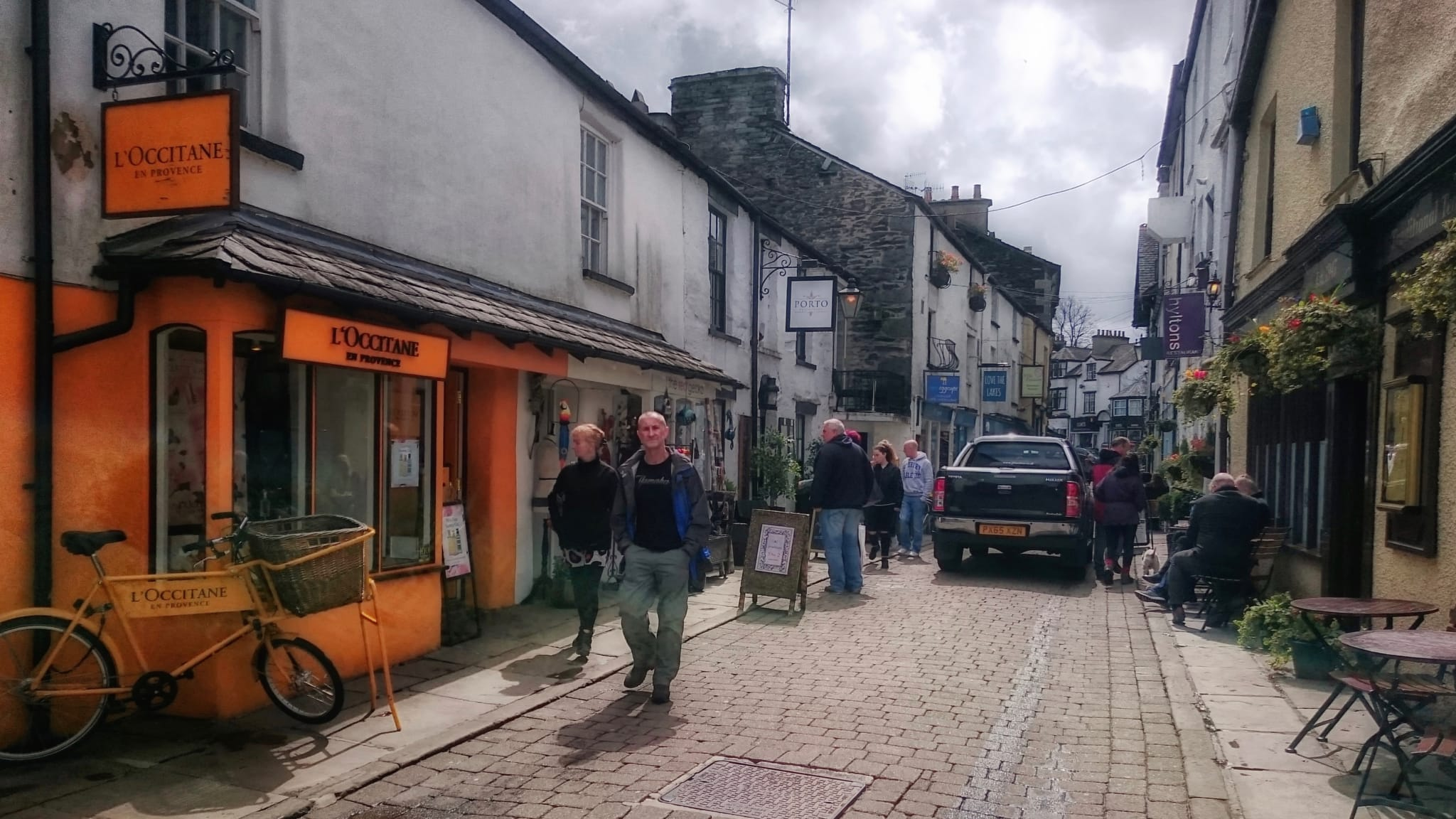 The cobbled lane of Ash Street off Crag Brow in Bowness-on-Windermere, narrow and full of shops.