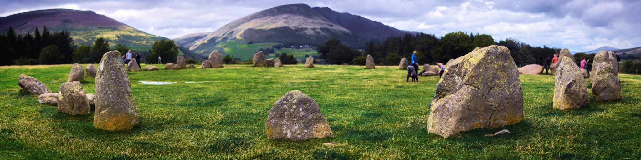 An ultra-wide panorama of Castlerigg Stone circle, with Blencathra and Lonscale Fell looming behind.