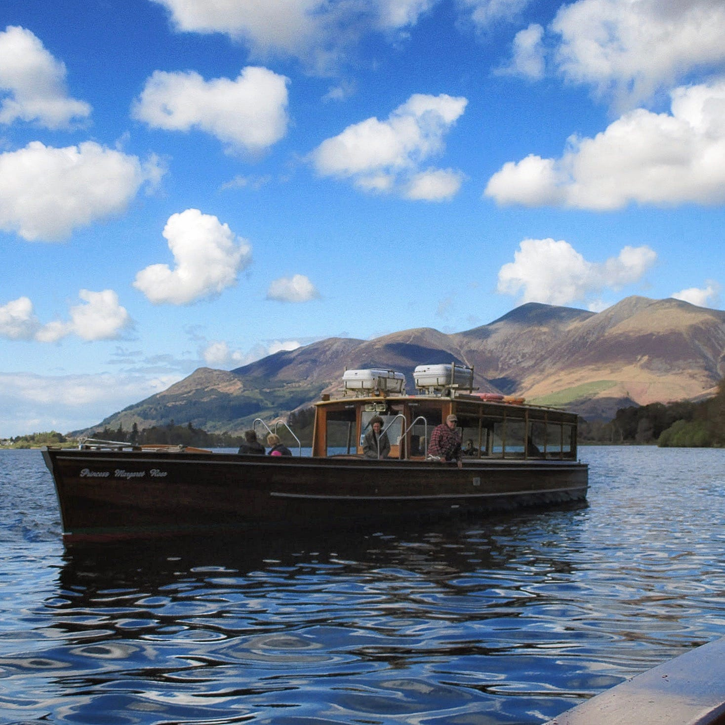 "The ""Princess Margaret Rose"", photographed just off Ashness landing stage two miles south of Keswick. The mountain behind it is Skiddaw. Photo by Antiquary, licensed CC-by-SA-4.0."
