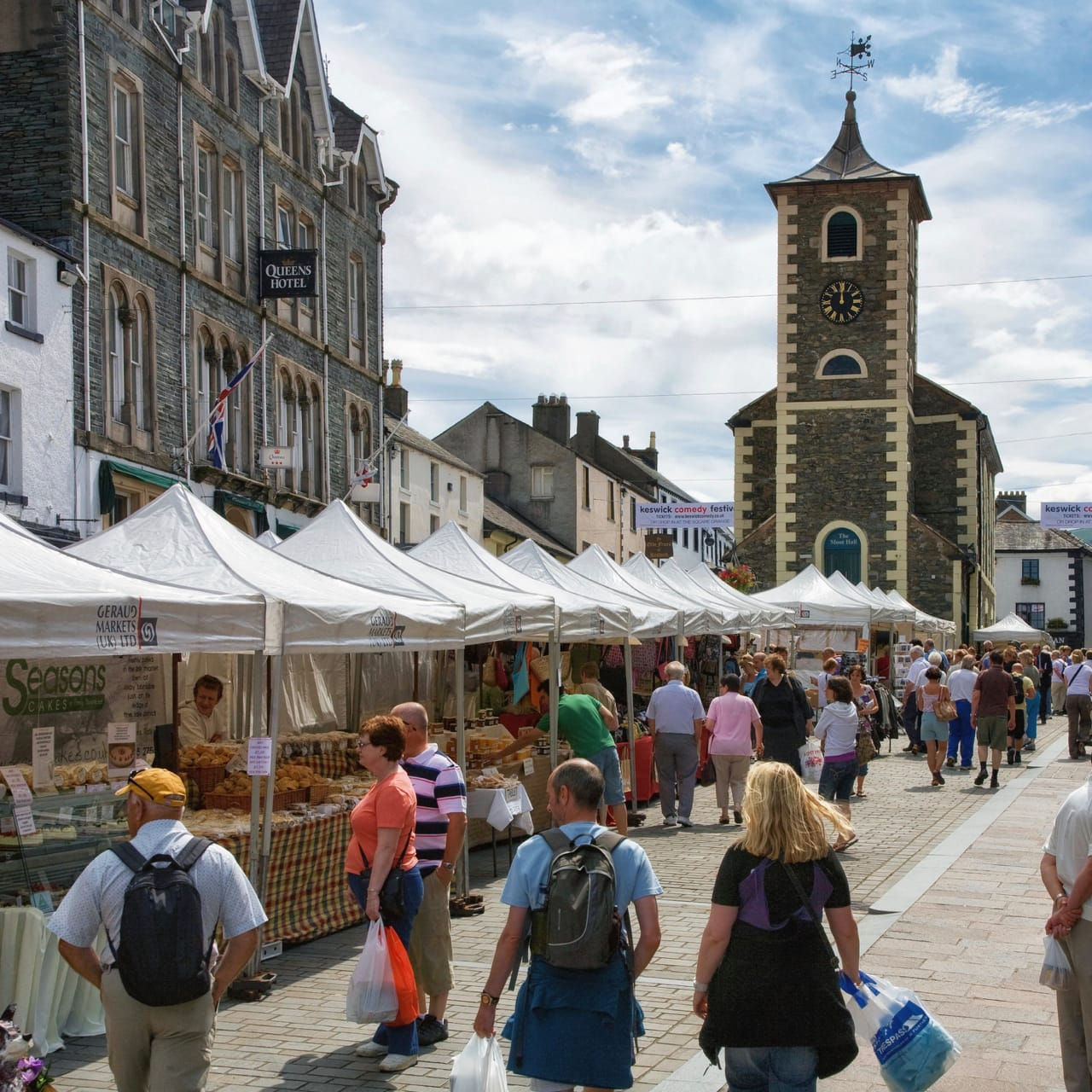 Keswick outdoor market on a sunny day, with Moot Hall at its head. Photo by DAVID ILIFF. License: CC BY-SA 3.0