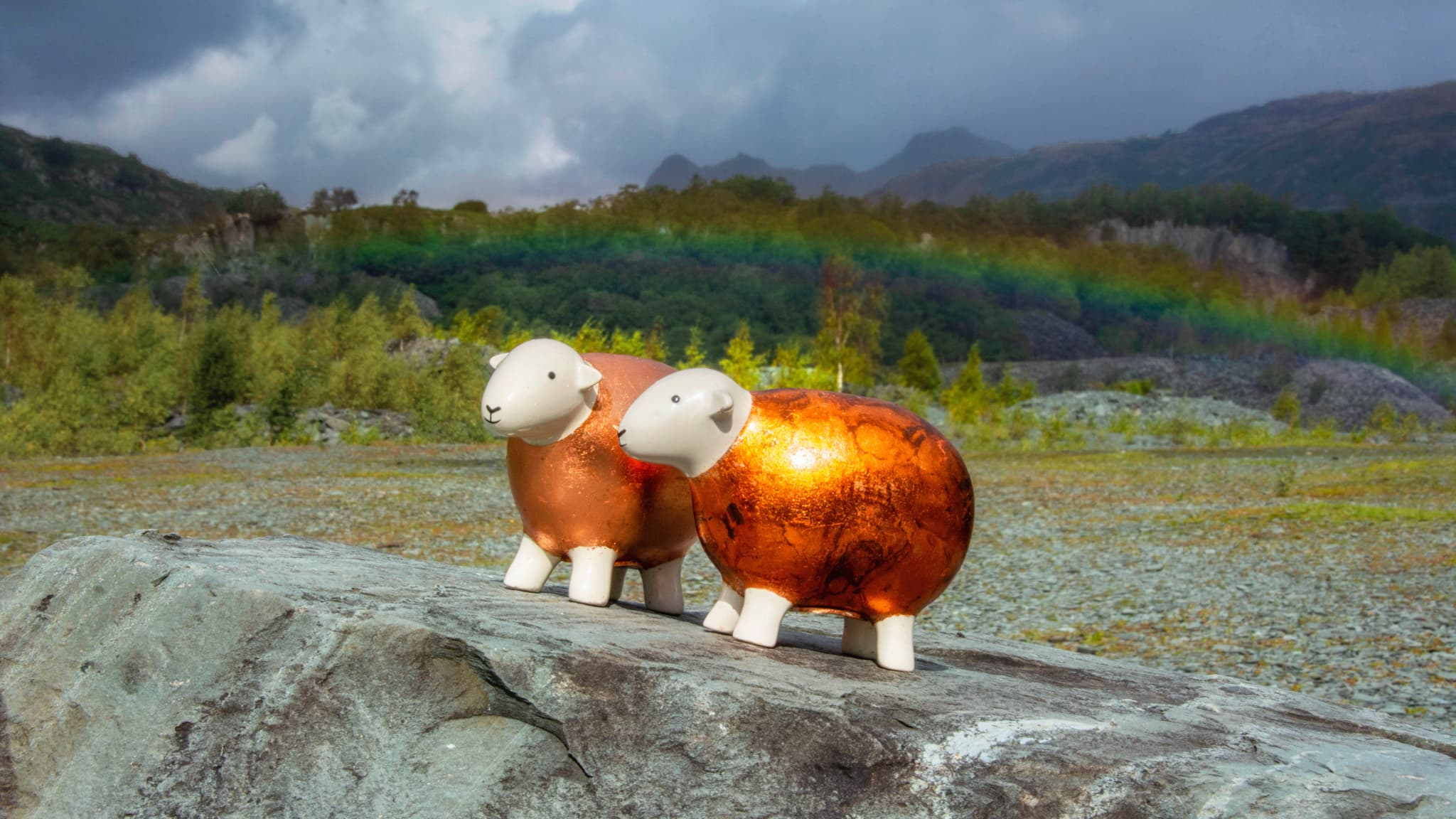 Two copper-gilded Herdys enjoy the sights of Hodge Close Quarry with a rainbow in the background