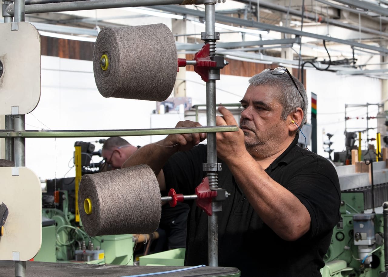 The wound yarn is loaded onto a warp drum, ready for warping