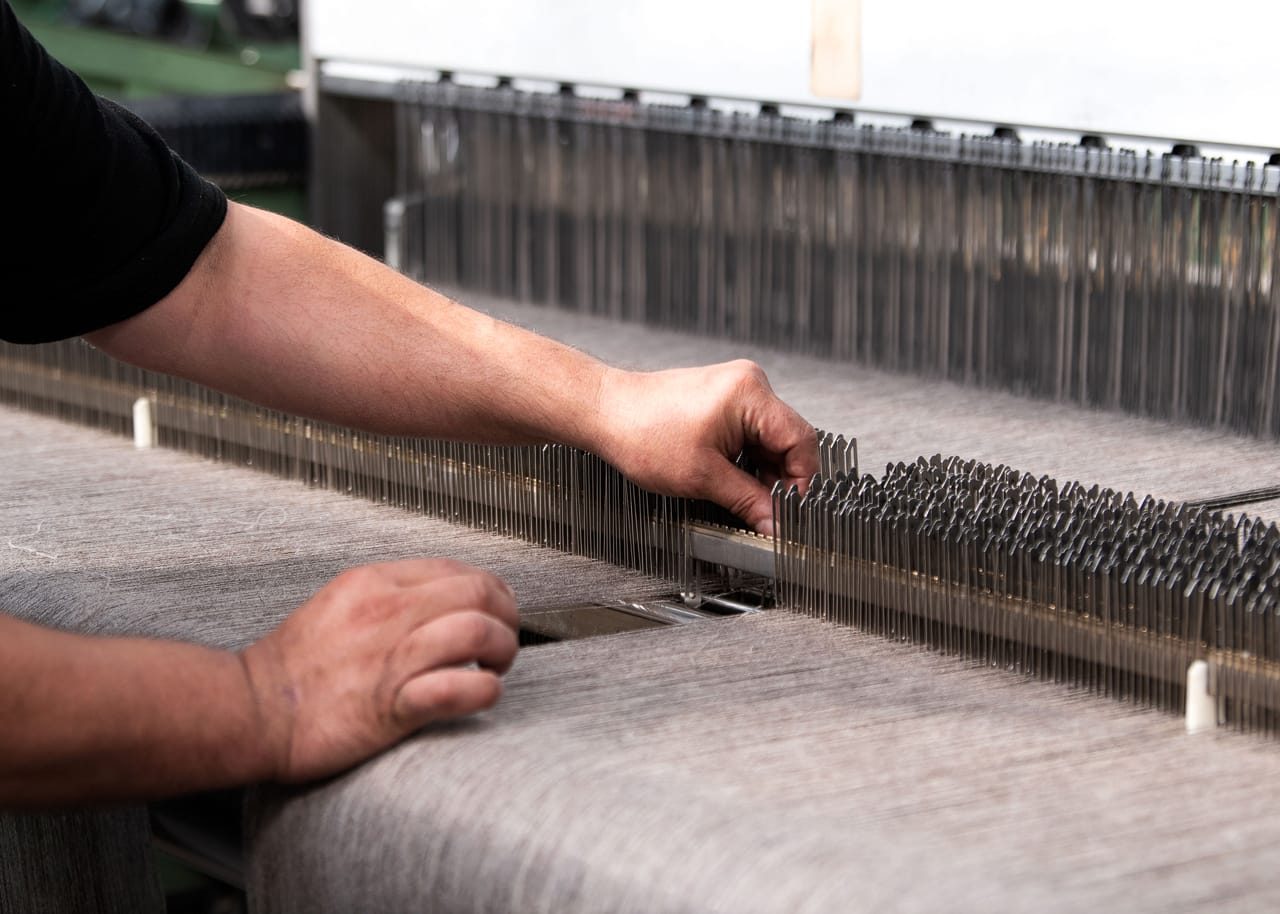 Textile engineers can operate multiple looms at once