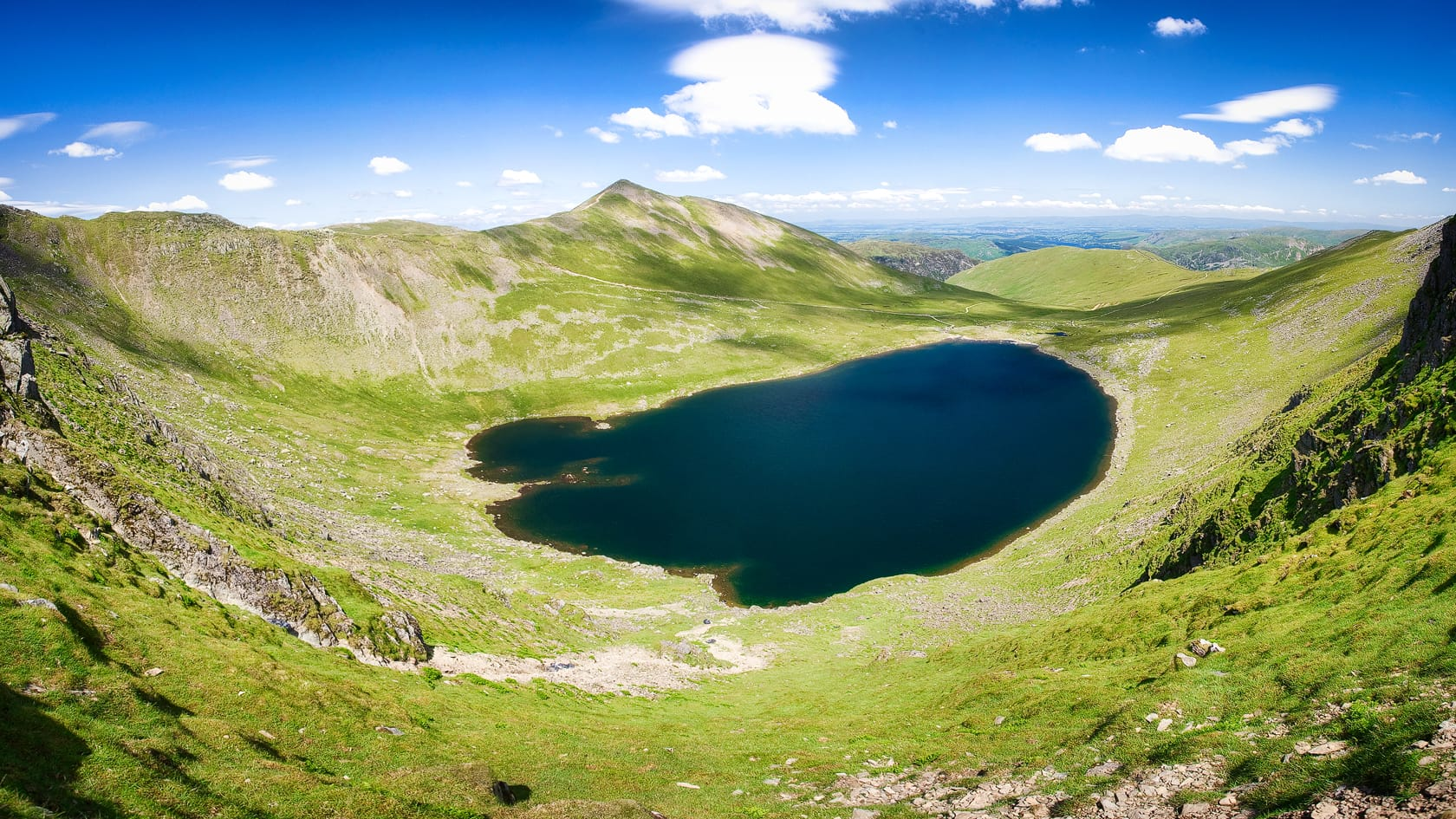 Red Tarn, just below the summit of Helvellyn on a fine summer's day. Photo by DAVID ILIFF. License: CC BY-SA 3.0