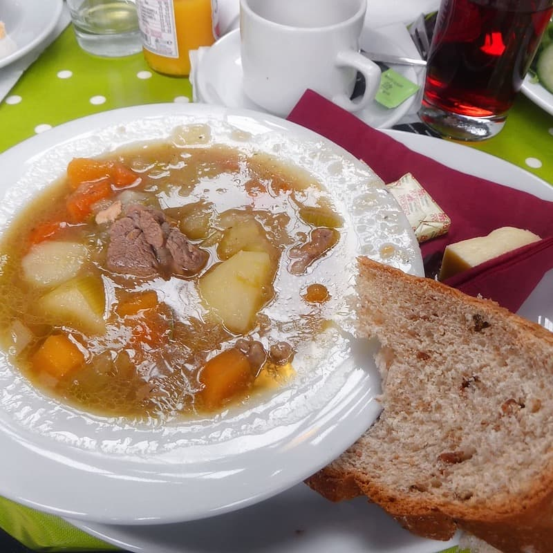 A lamb cawl with crusty bread